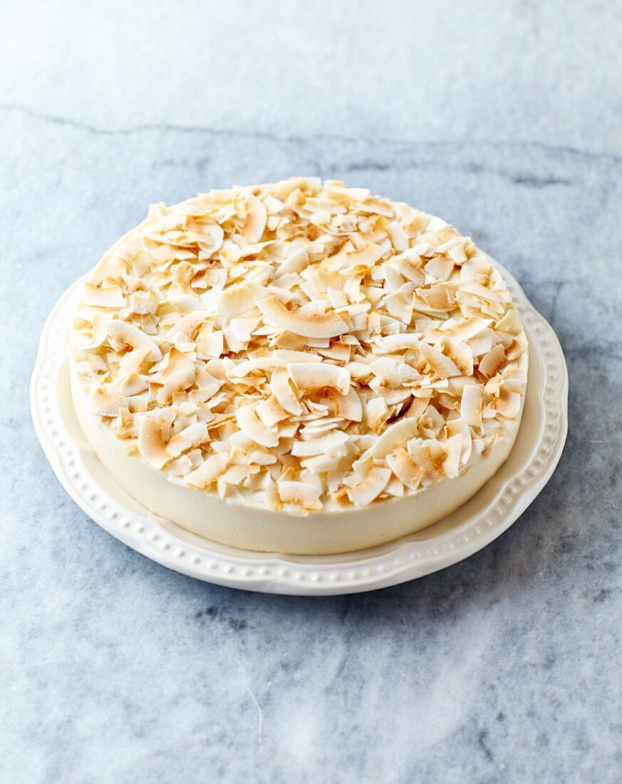 Cheesecake made with coconut milk and decorated with toasted coconut