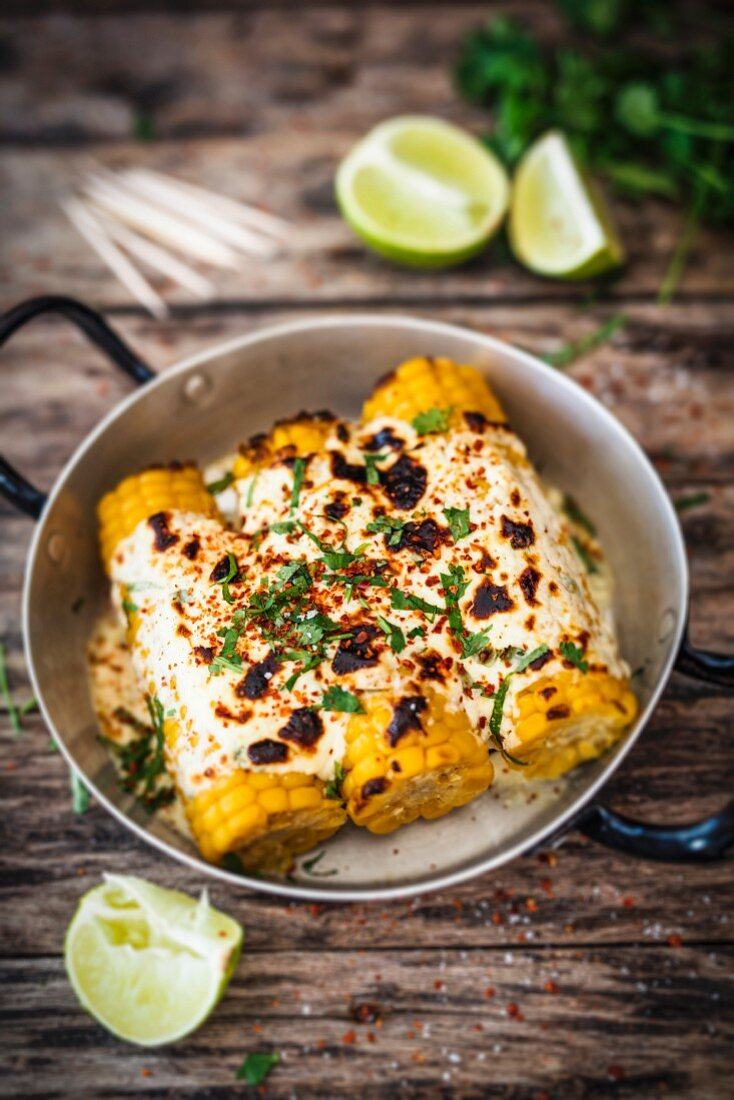 Elotes (corn on the cob with melted cheese, Mexico)