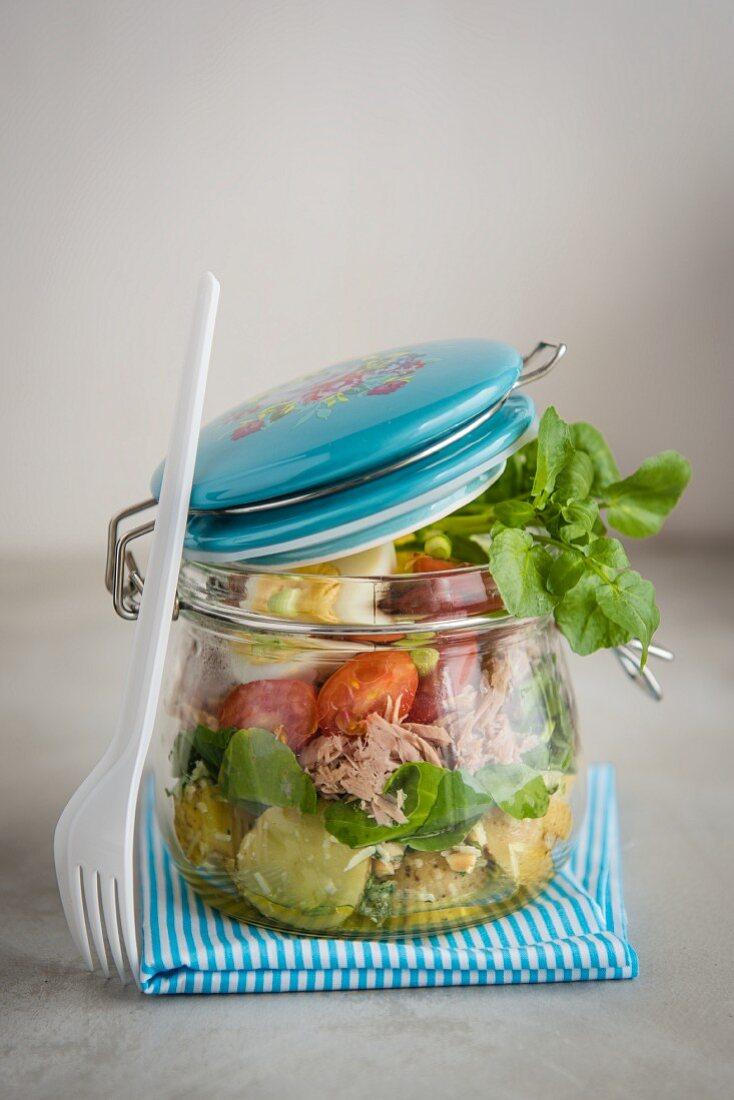 Potato, pesto, egg, tomato and watercress salad in a jar