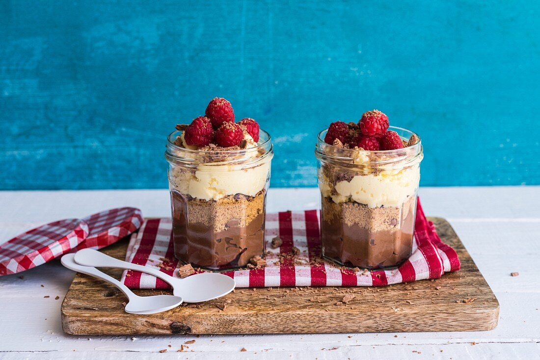 Meal in a Jar: Dark Chocolate Cheesecake topped with Crushed Biscuits and Cacao Nibs and White Choc Cream