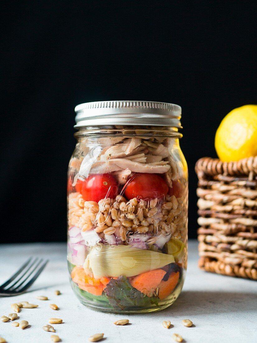 Chicken and farro salad in a mason jar