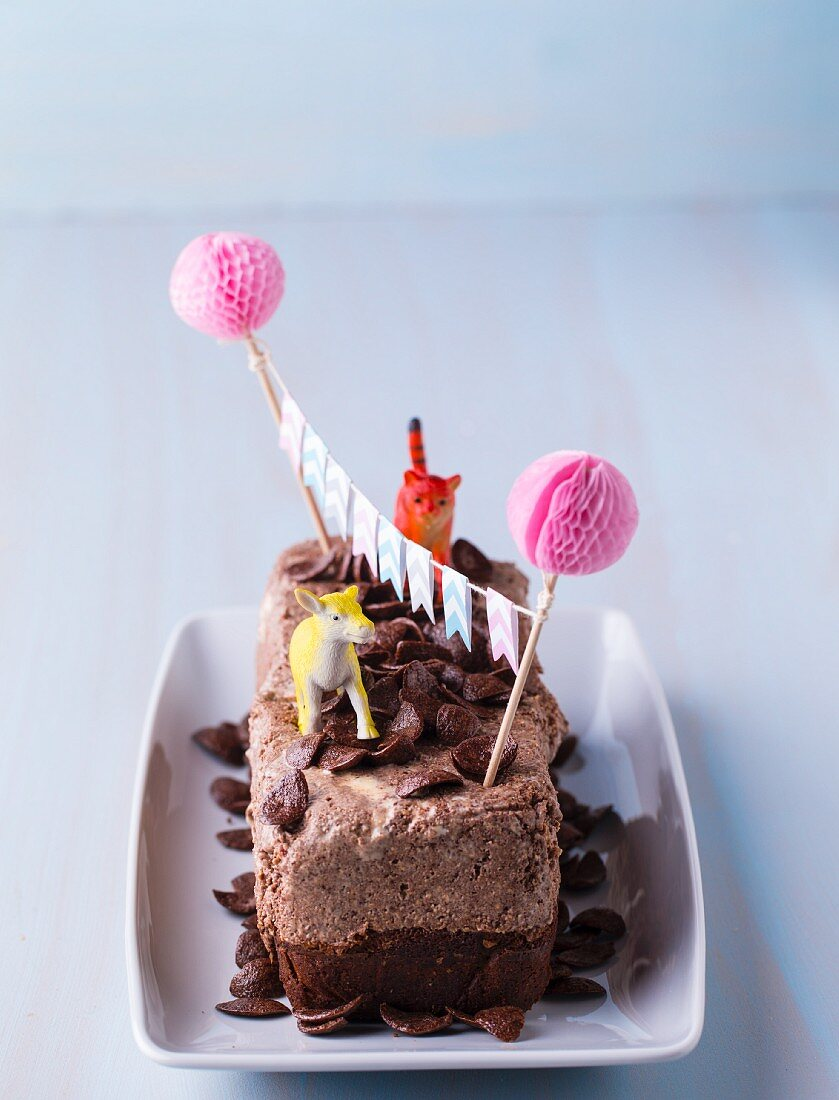 Chocolate cake with cereal and animal figurines for a children's party