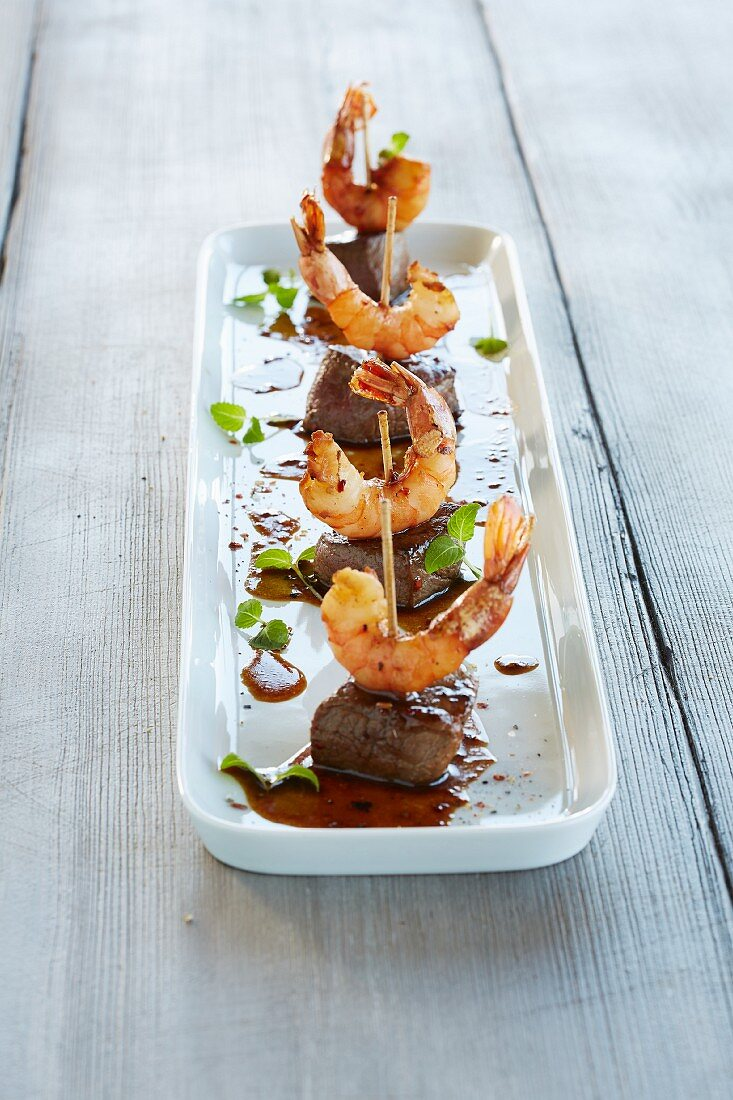 Surf and turf: meat skewers with shrimp