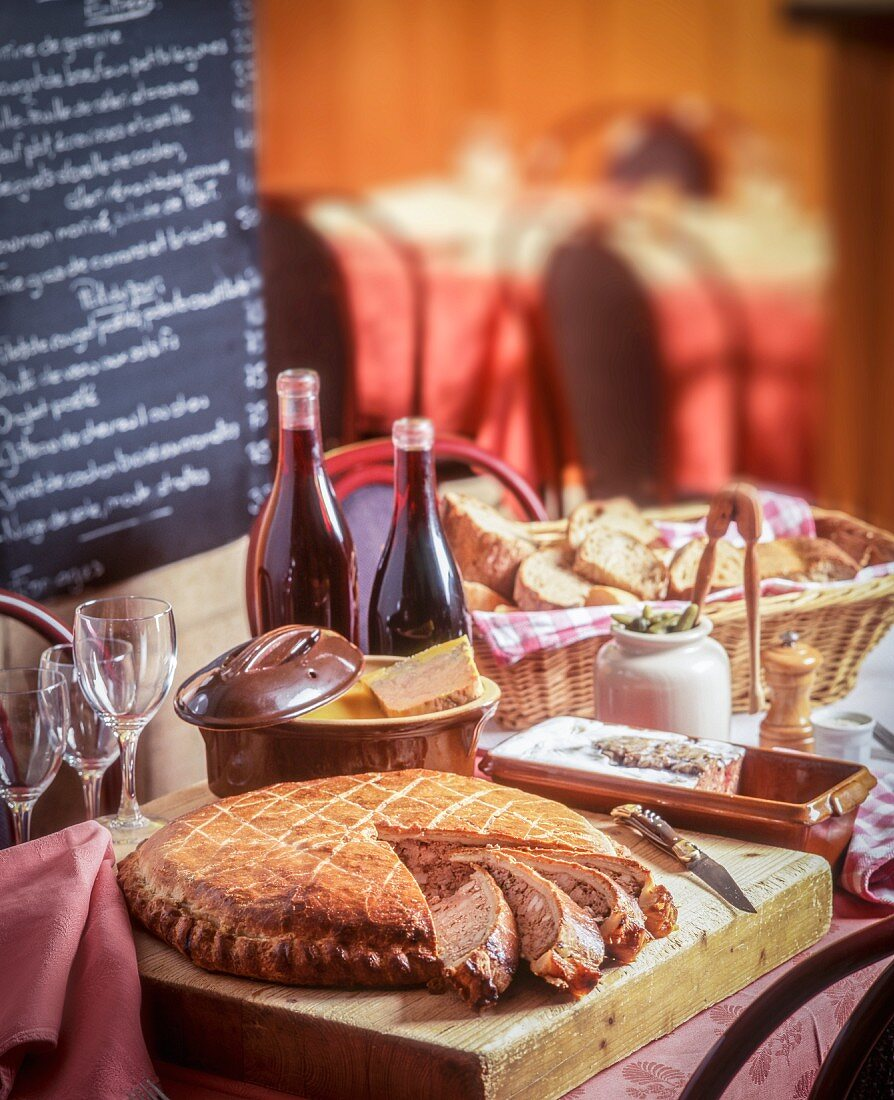 Various goose liver pates with wine and bread in a bistro