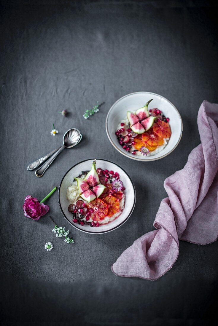Millet porridge with almond milk, pomegranate seeds, fig, blood orange and chocolate chips