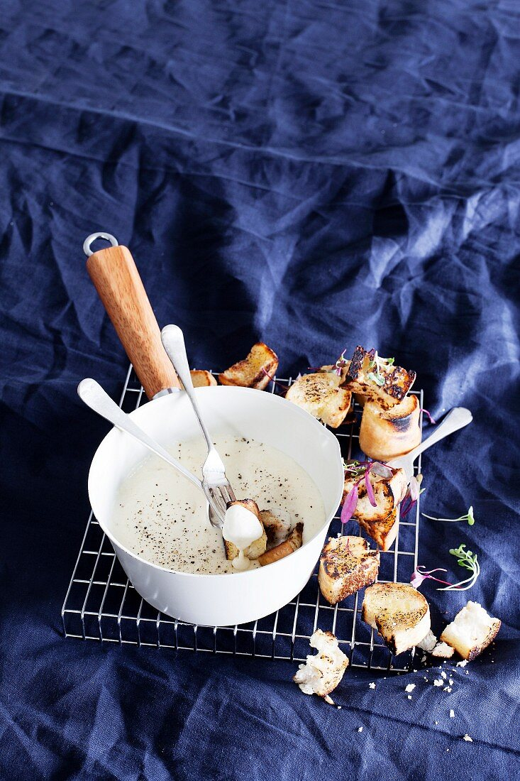 Traditional cheese fondue with toasted bread