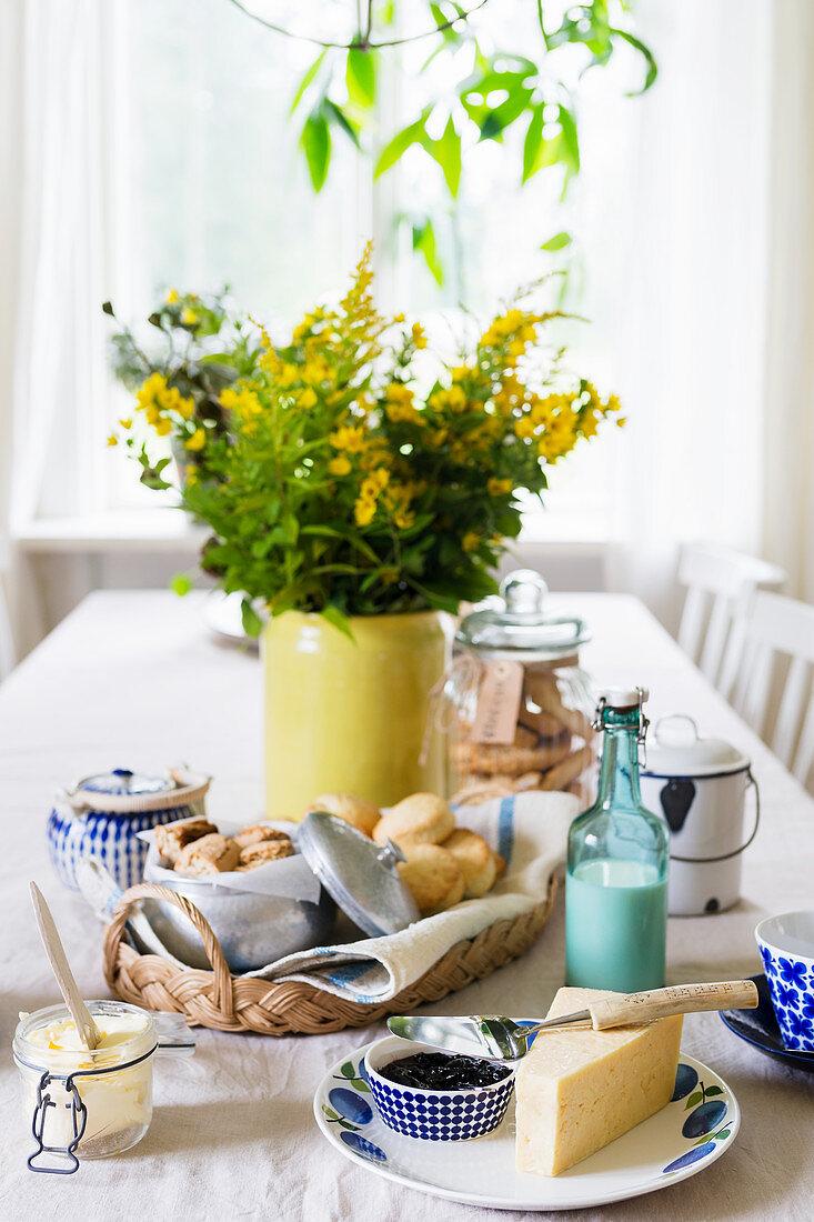 Breakfast table set with blue-patterned crockery