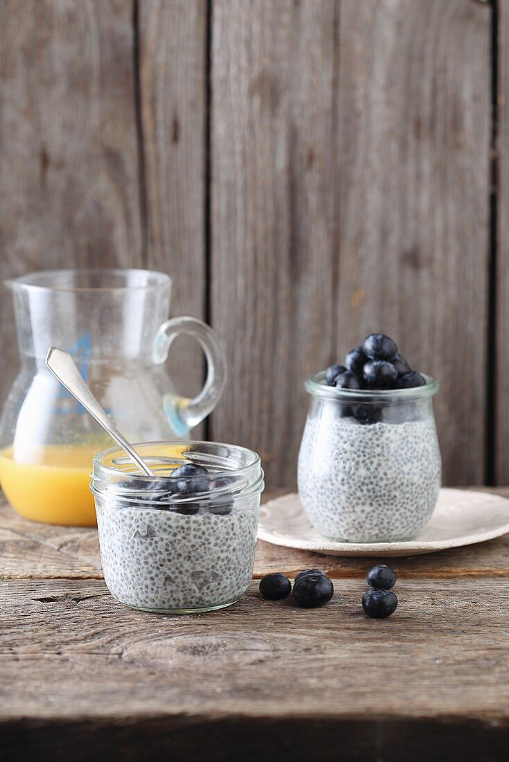 Chia pudding with blueberries in glass jars