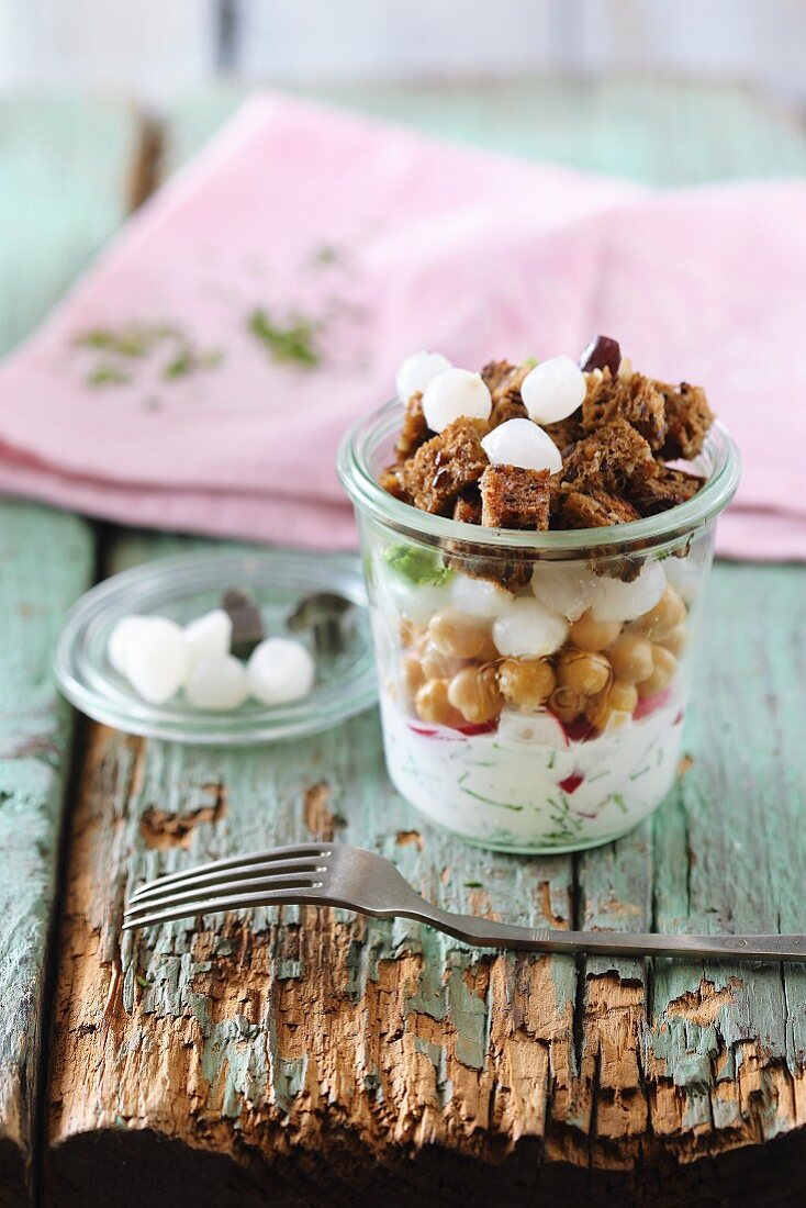 Chickpea and onion salad in a glass with croutons