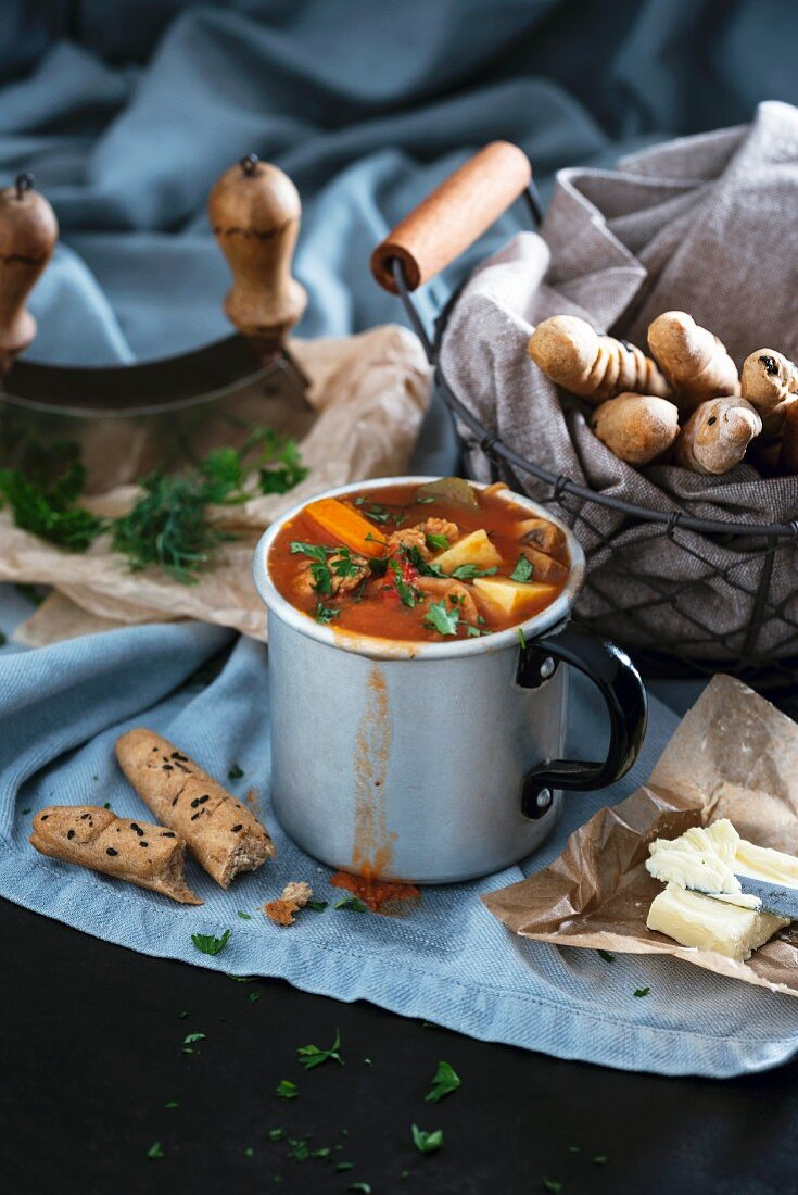 Vegan goulash soup with potatoes, carrots, paprika and soya strips