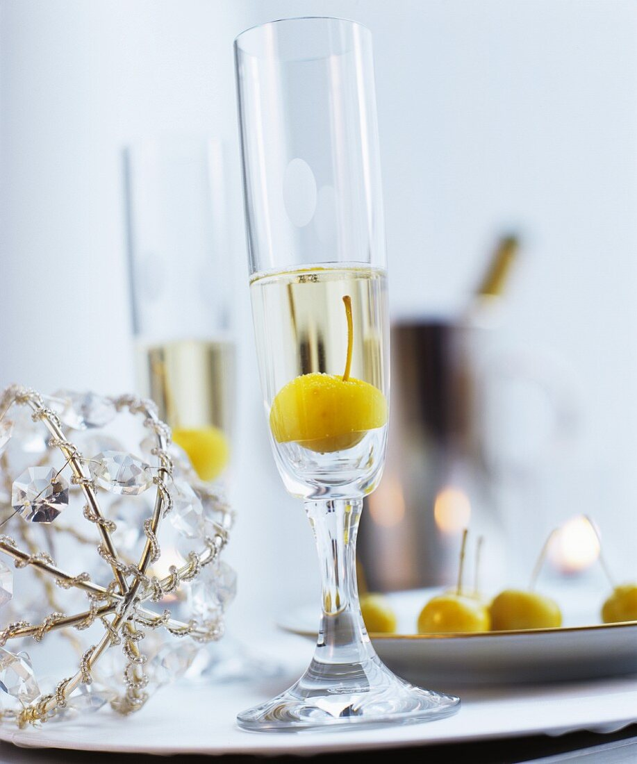 Mirabelle plum in glass of Prosecco