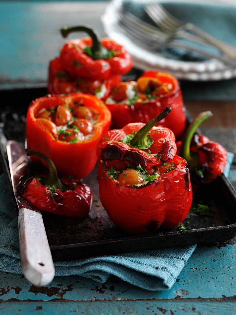 Stuffed peppers with cherry tomatoes and basil