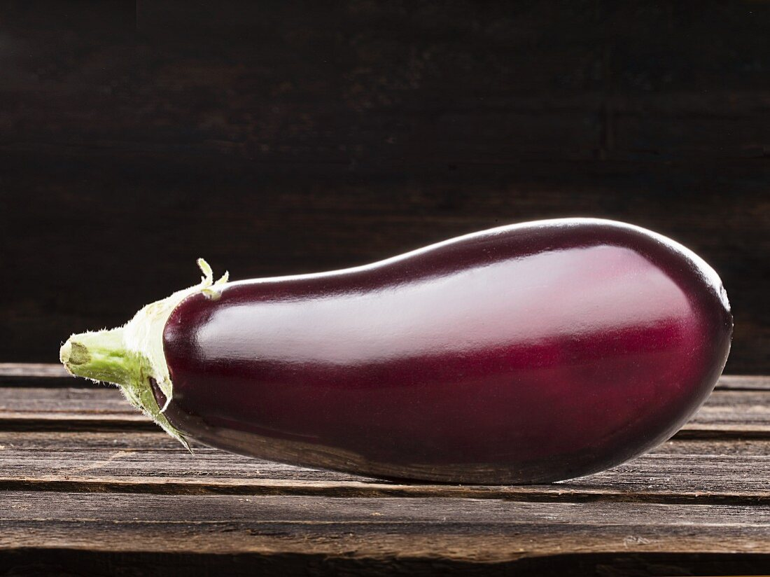 An eggplant on a wooden background