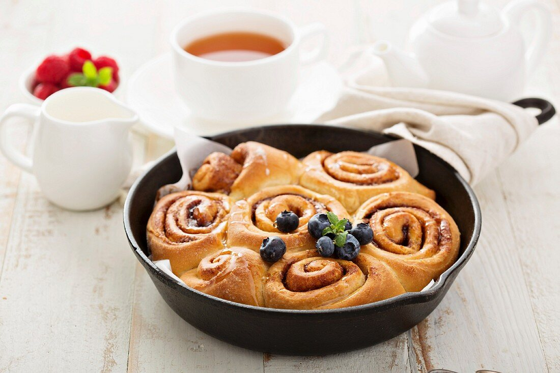 Cinnamon buns baked in a cast iron skillet