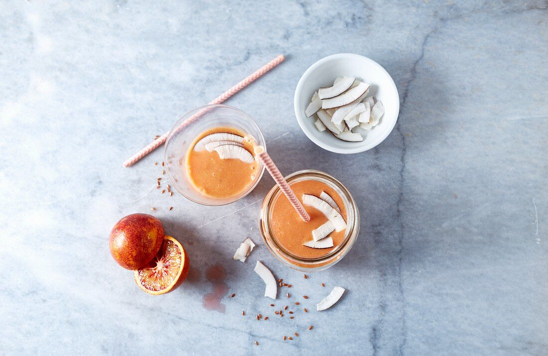 Blood orange smoothie with apple, coconut and flaxseeds (seen from above)