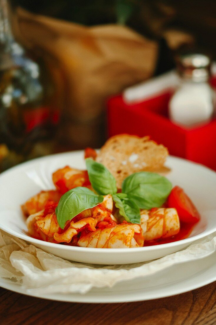 Tomato soup with seafood, basil and bread