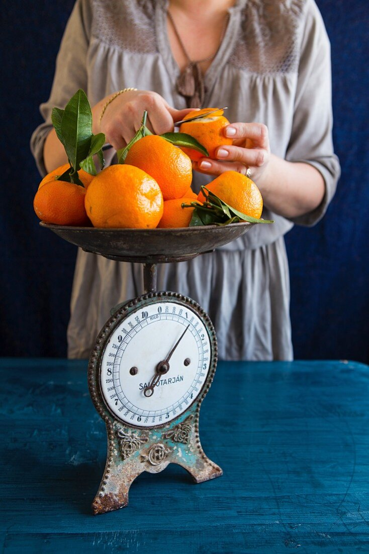 A woman peeling oranges