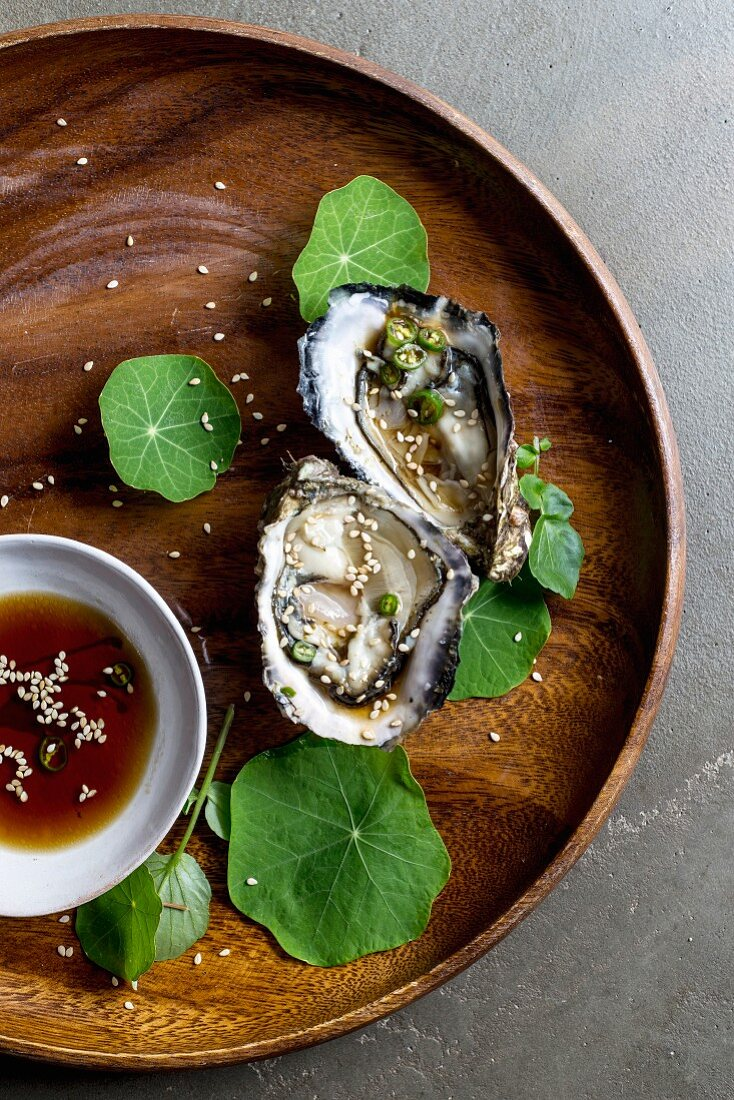 Fresh oysters with sesame dressing and nasturtium leaves