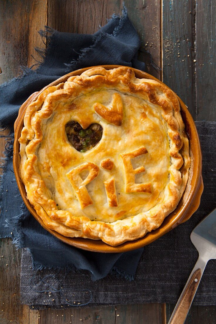 A meat pie with 'Pie' lettering and a dough heart