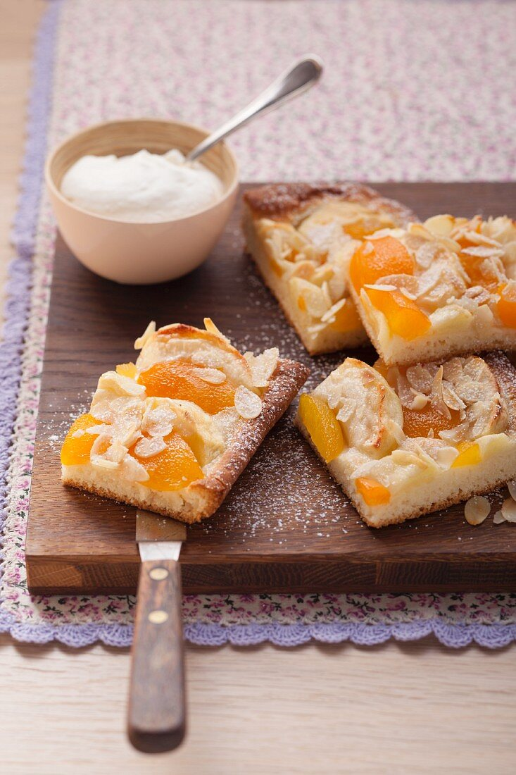 Apricot apple cake with almond flakes