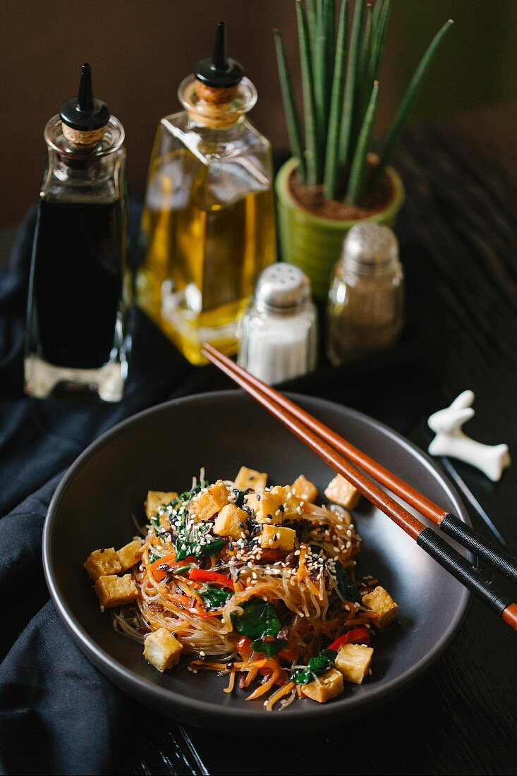 Glass noodles with vegetables, tofu and sesame