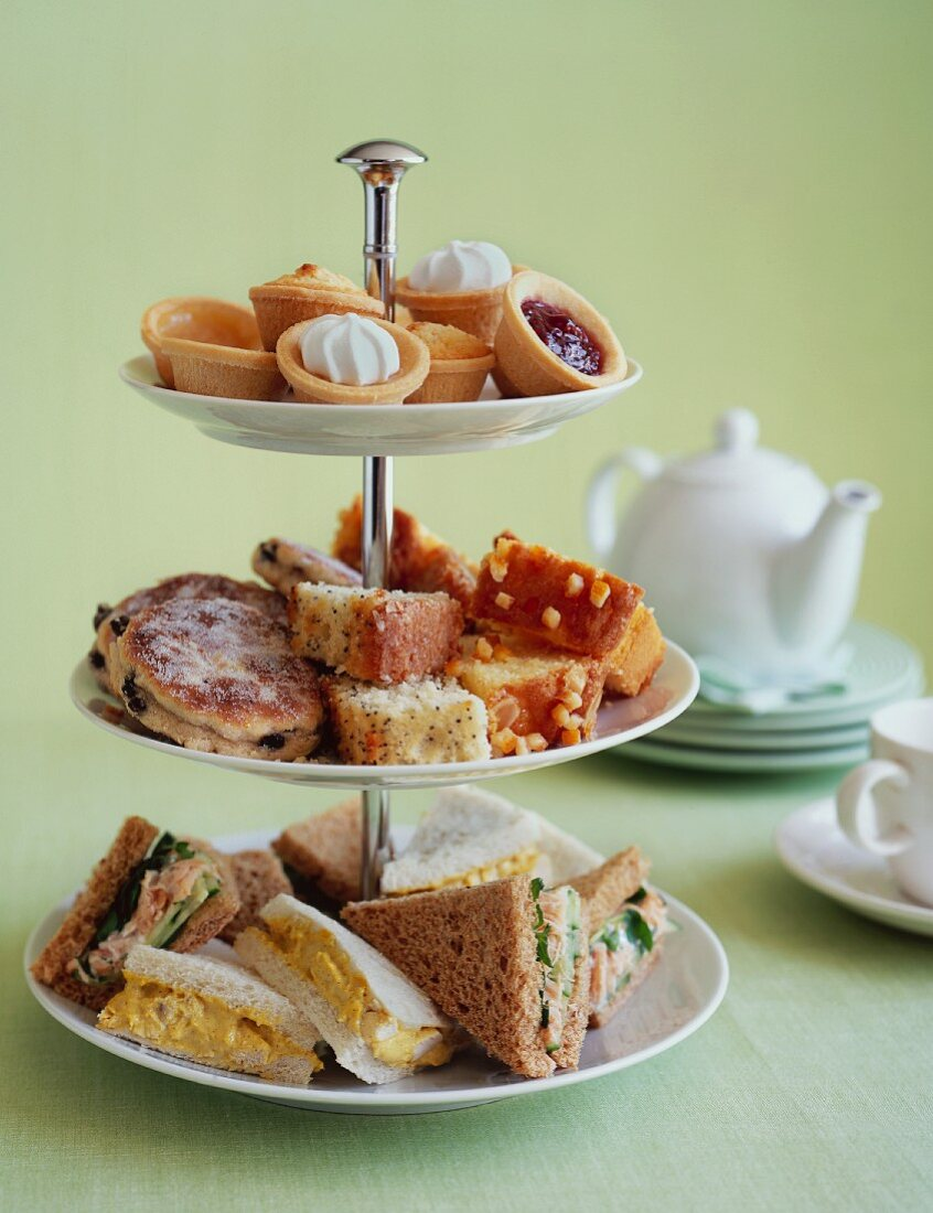 Pastries and sandwiches on a stand for afternoon tea