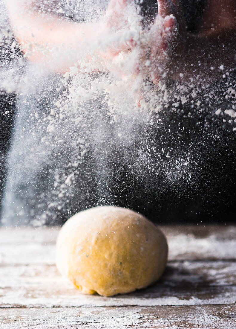 Dough ball and work surface dusted with flour