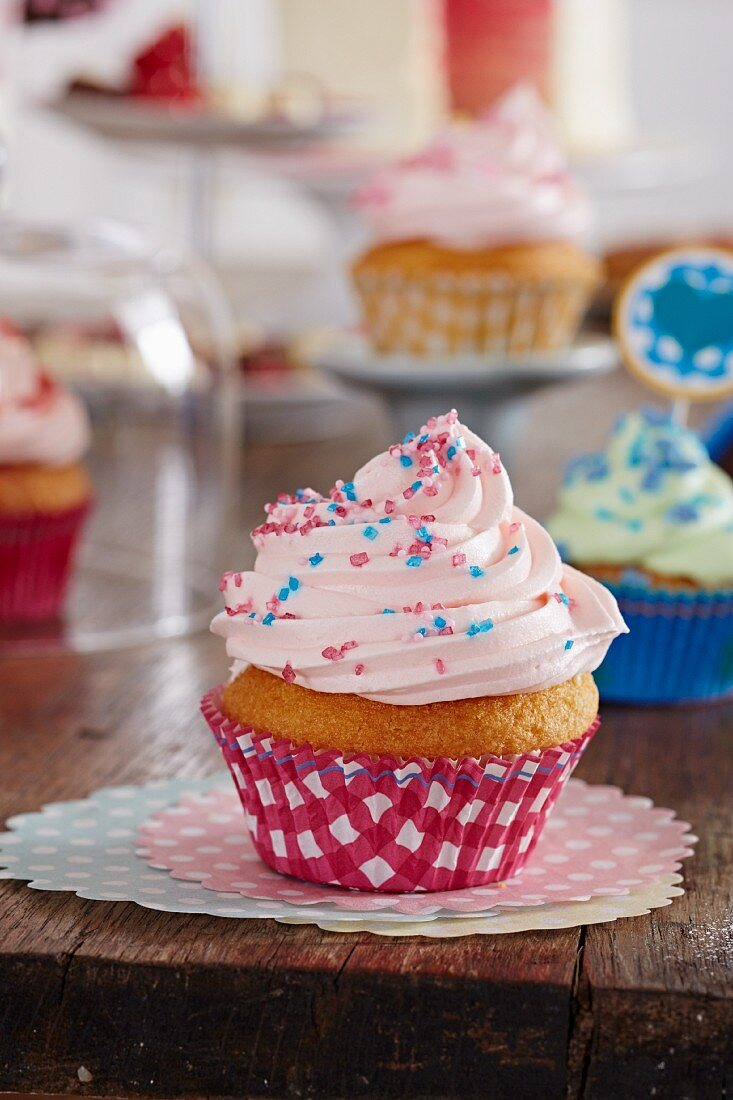 A cupcake with pink frosting