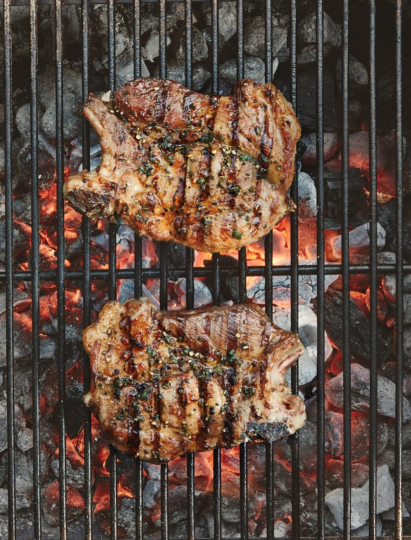 Veal chops on a grill (top view)