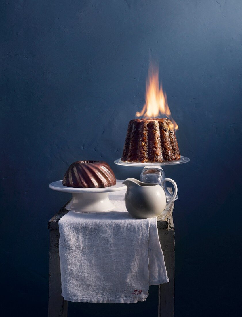 Chocolate pudding and flambéed plum pudding