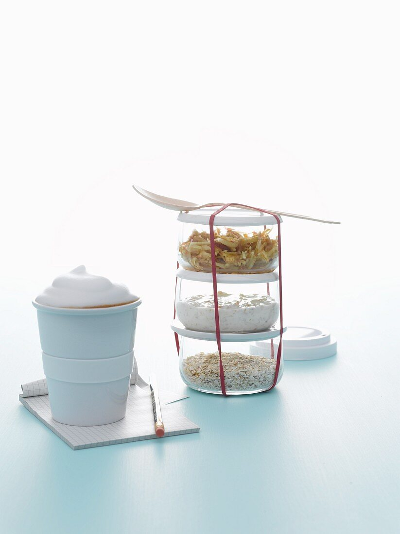 Bircher muesli, apple. oats, raisins and coffee with milk for breakfast