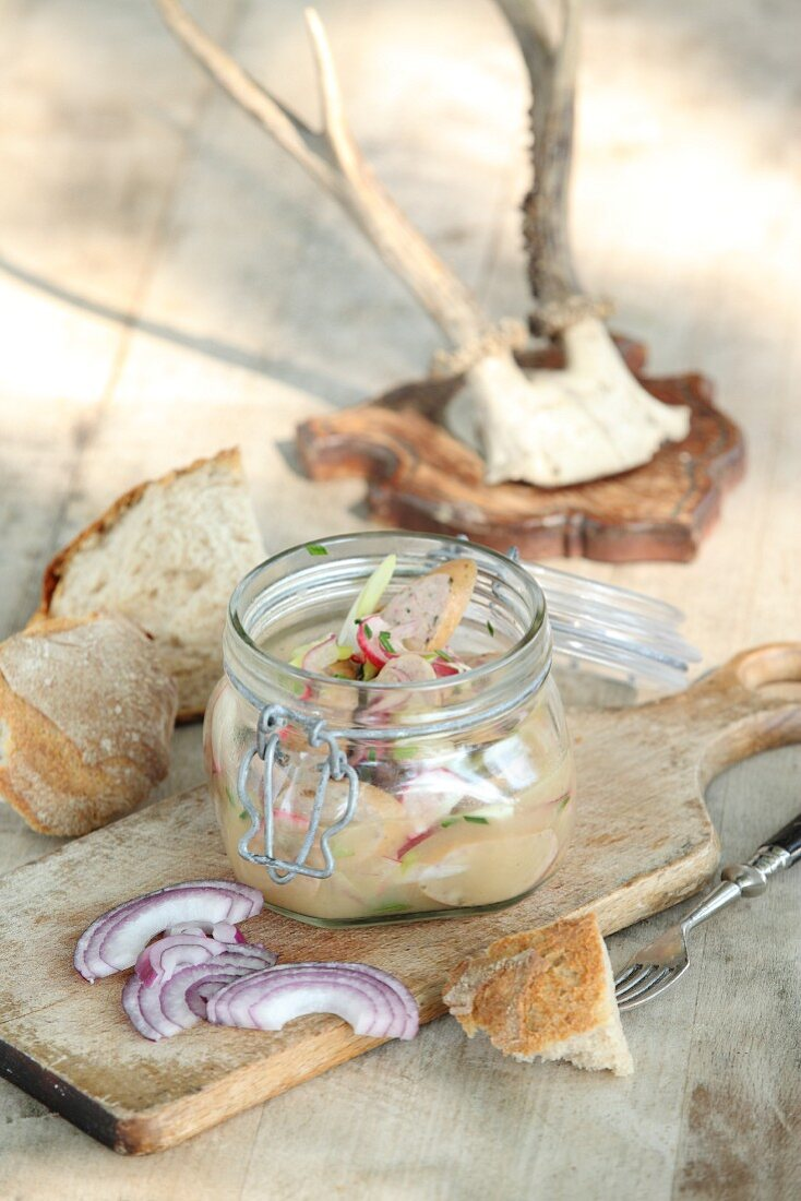 Beer garden salad with radishes in a glass jar