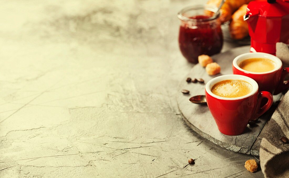 Breakfast with fresh Coffee, strawberry jam and croissants