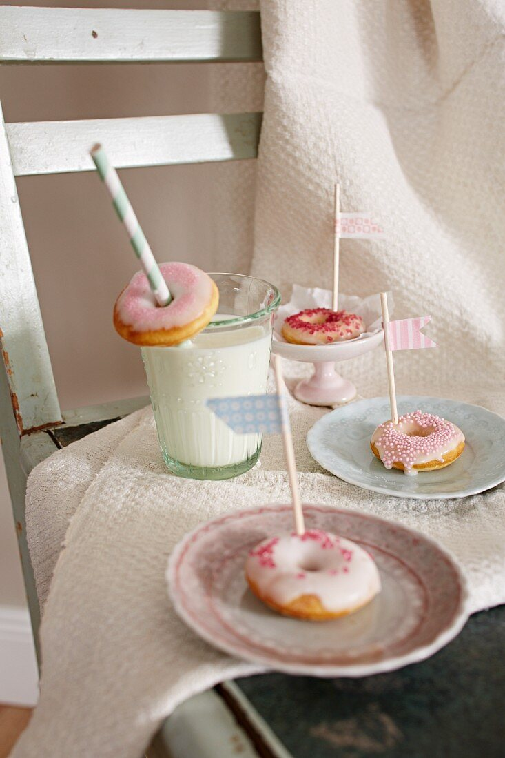 Mini doughnuts with flags and a glass of milk