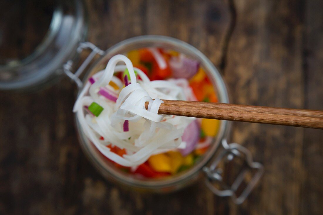 Glass noodle salad with yellow and red pepper, spring onion and red onion