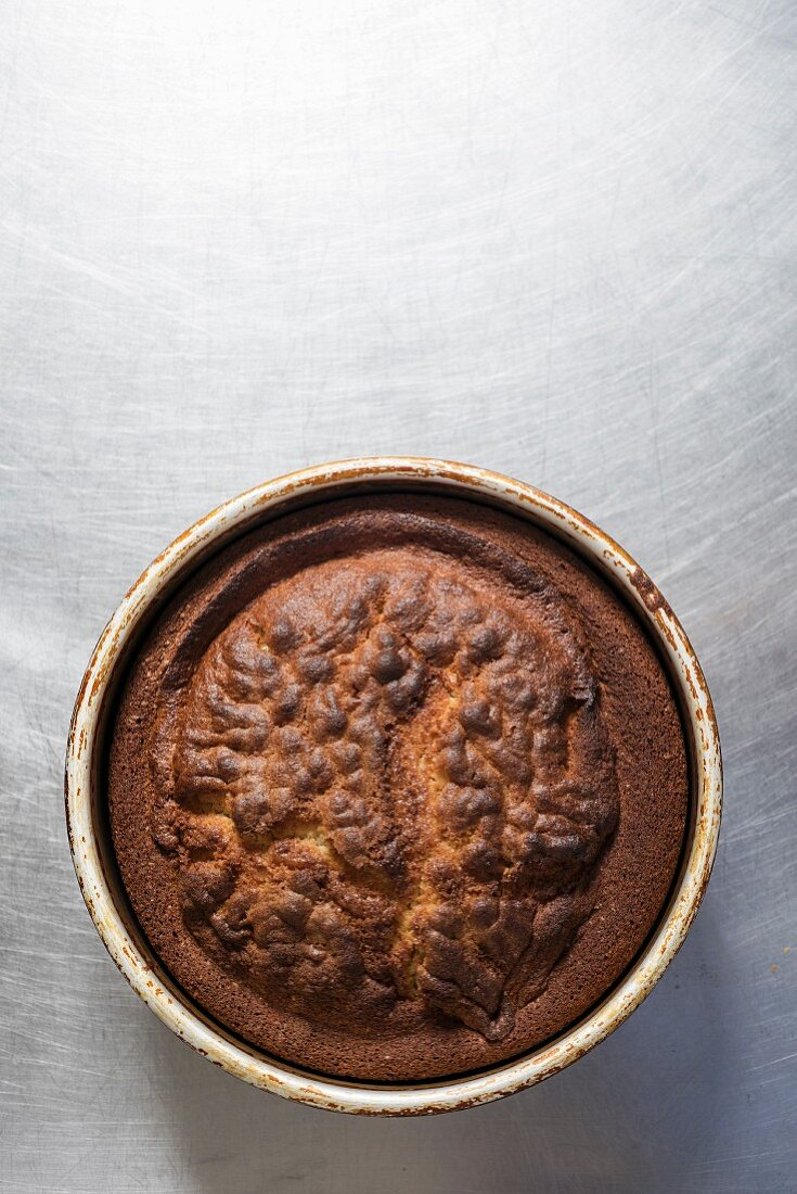 A freshly baked cake in a baking tin