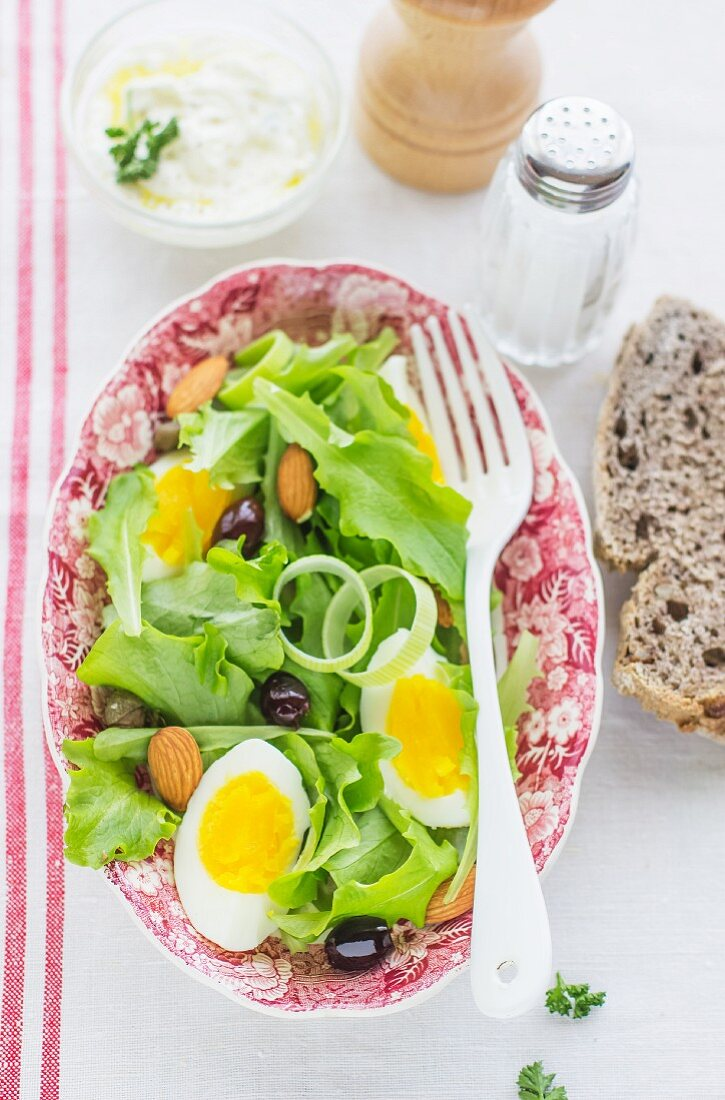 Salad with egg olives and almonds