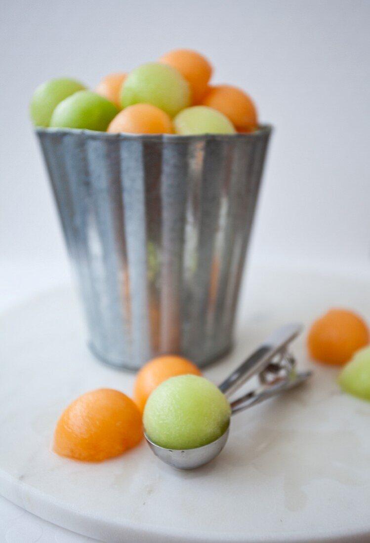 Melon balls in a metal bucket