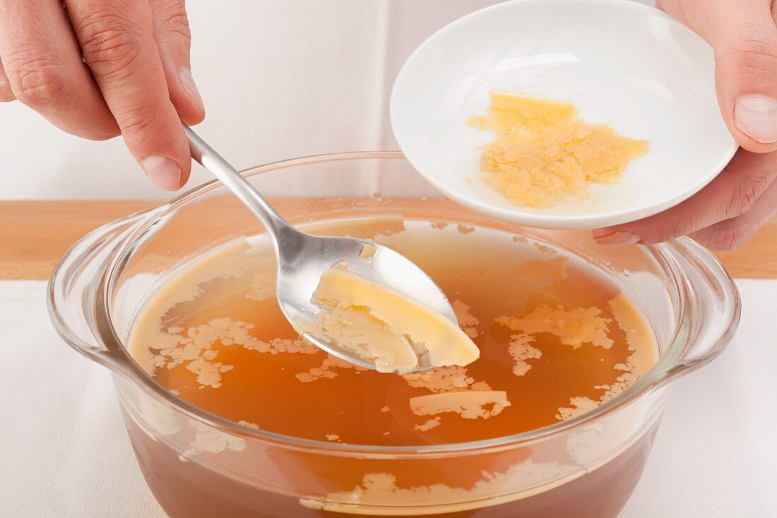 Removing the layer of fat from the cooled stock