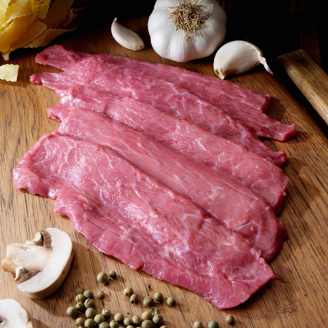 Veal cutlets on cutting board for Scaloppine