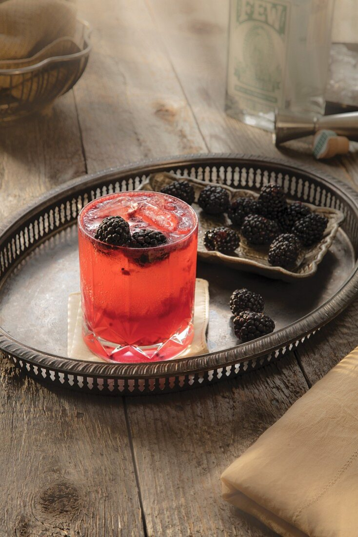 Blackberry beer cocktail on a silver tray