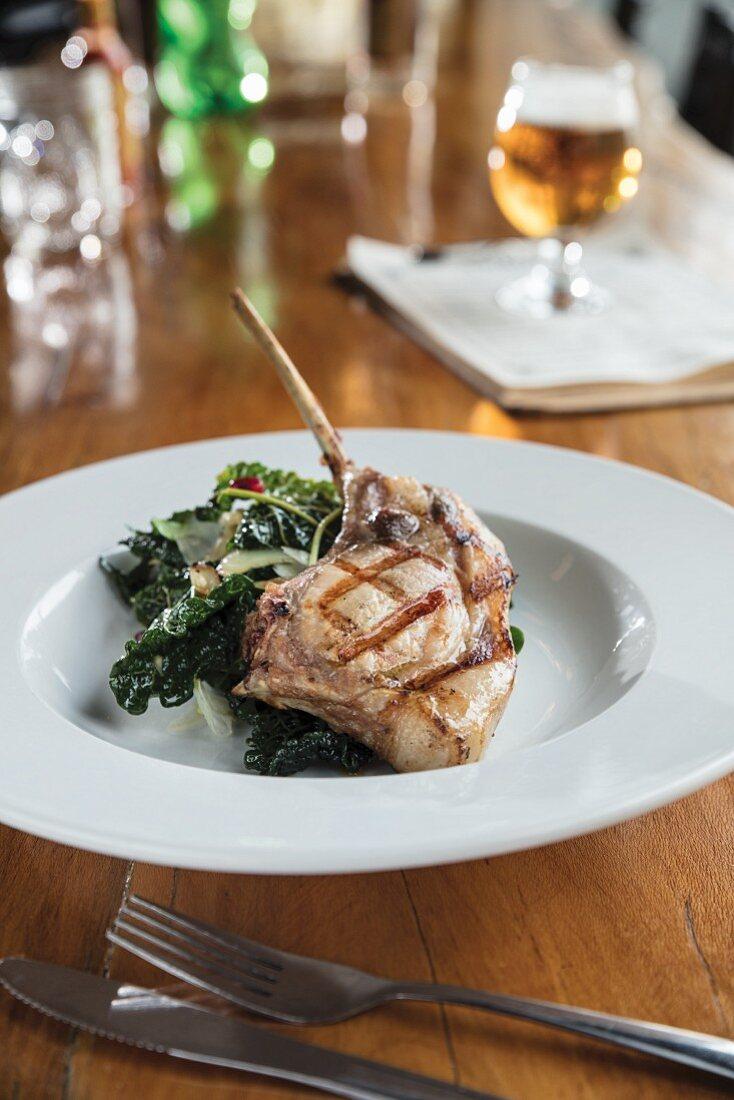 Bourbon Sweet Tea-Brined Grilled Pork Chops with Greens and Grilled Vidalia Onion Vinaigrette