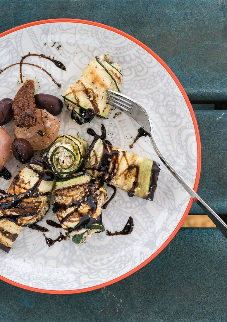 Aubergine and courgette rolls with cream cheese and balsamic dressing