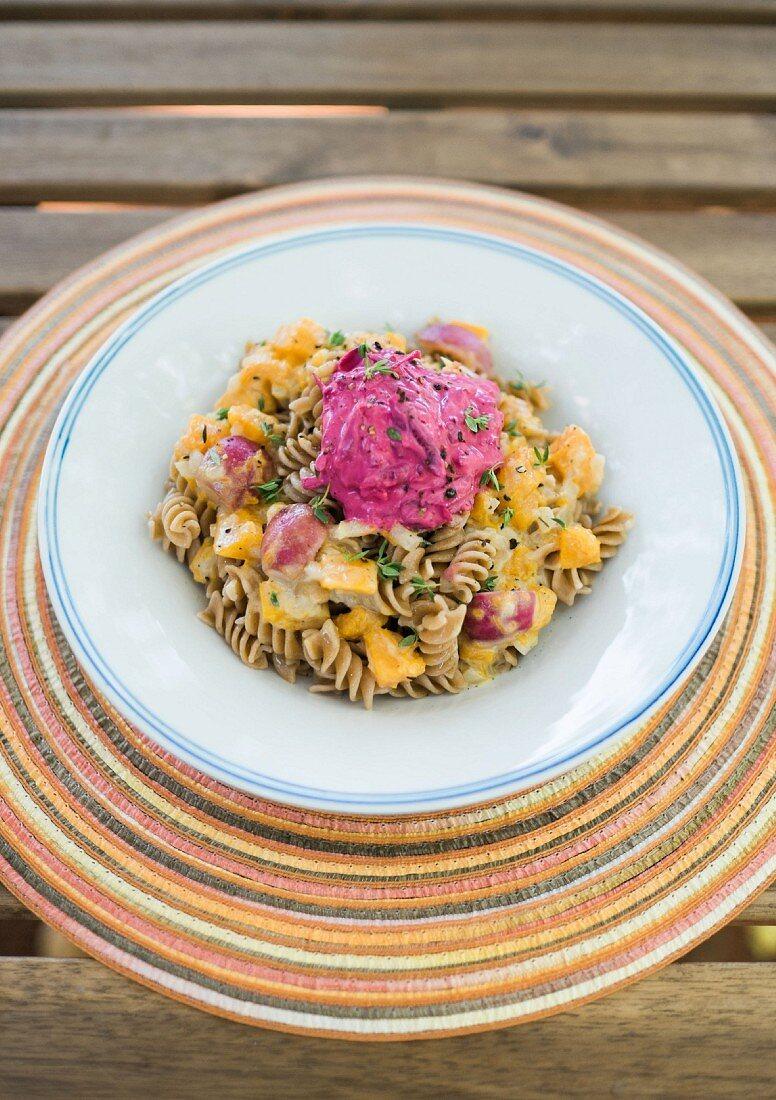 Spelt pasta with radish and pumpkin sauce and beetroot cream