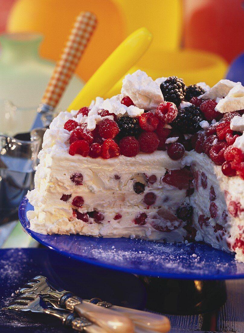 Ice cream gateau with meringue & berries, a piece cut