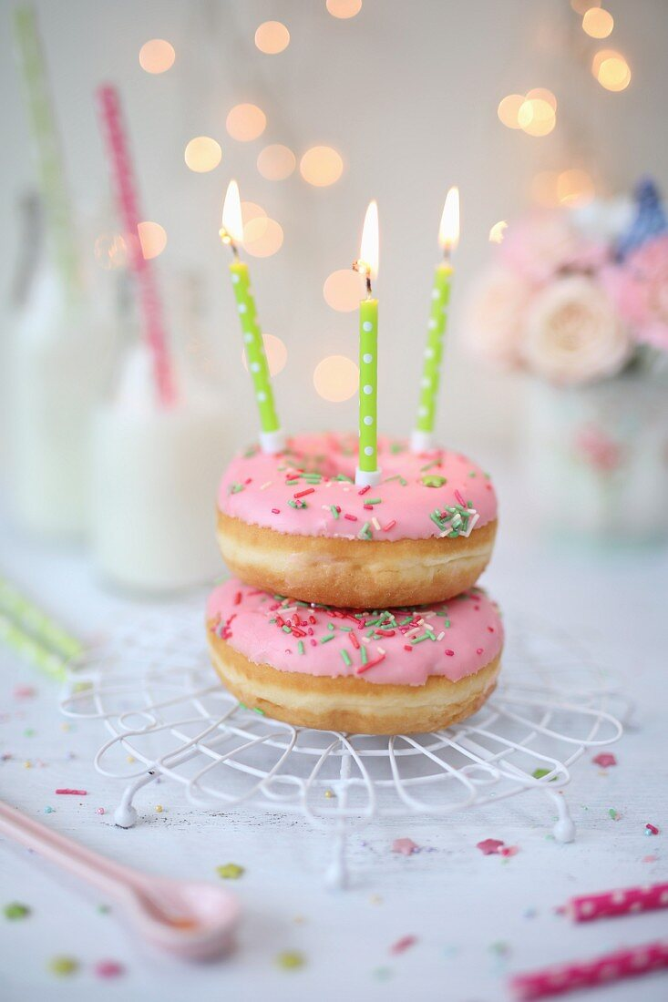 Pink doughnuts with birthday candles