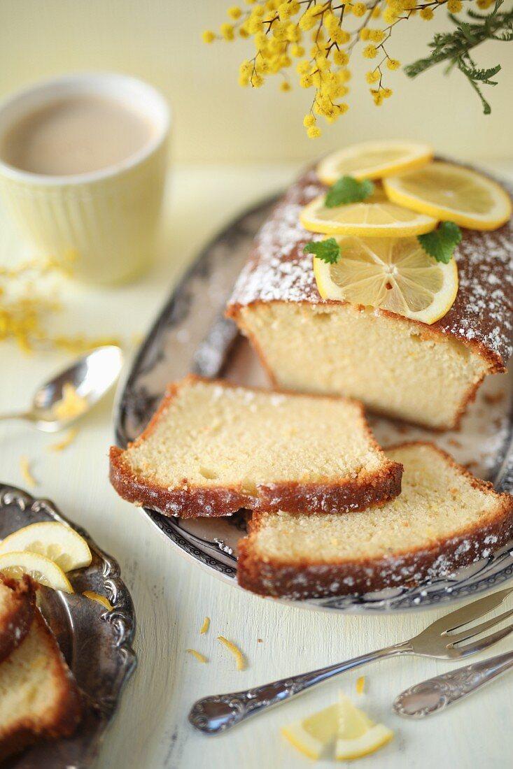 Sliced lemon cake and coffee