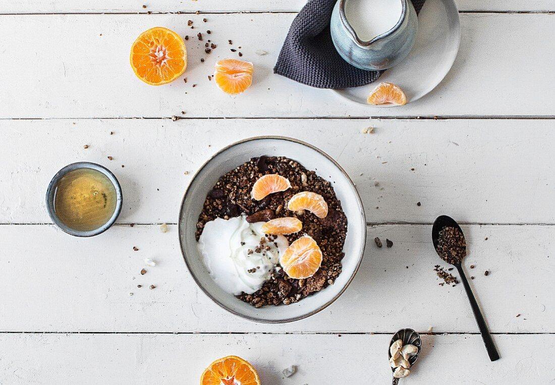 Gluten-free muesli with yoghurt and tangerines