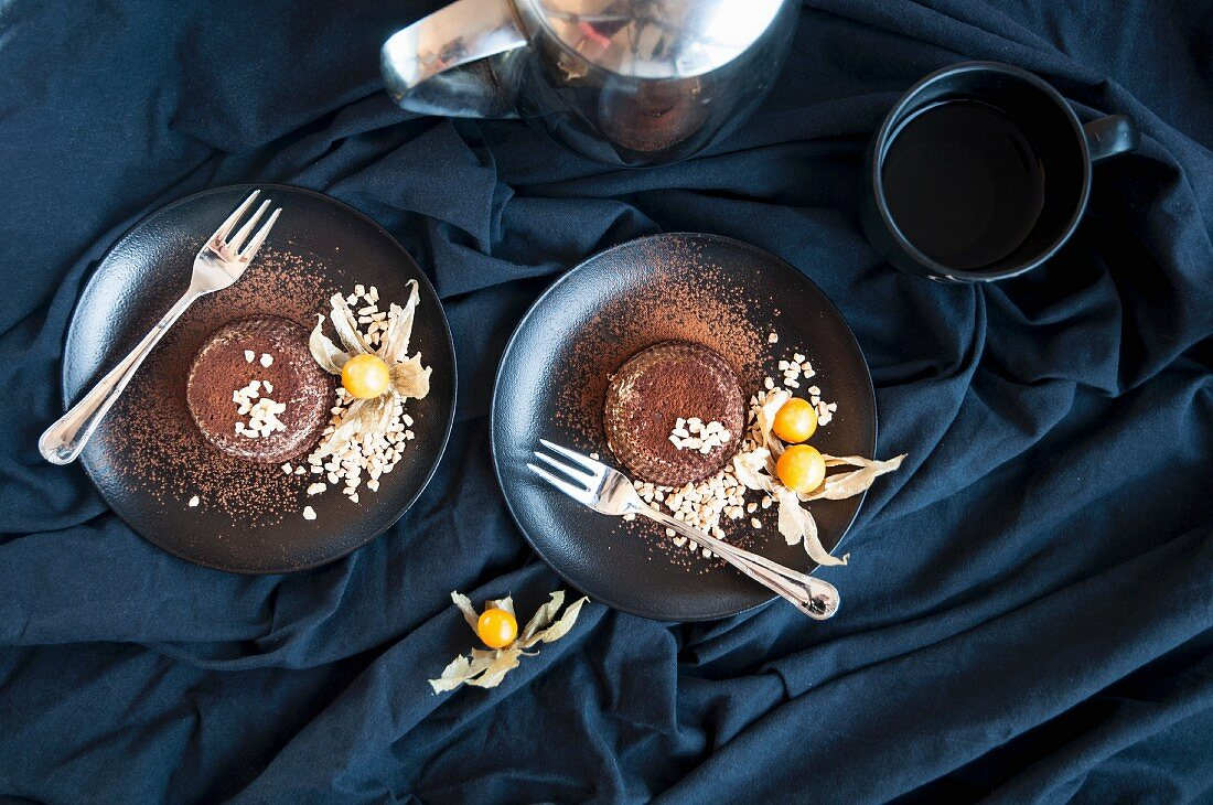 Chocolate lava cakes with almonds and physalis (seen from above)