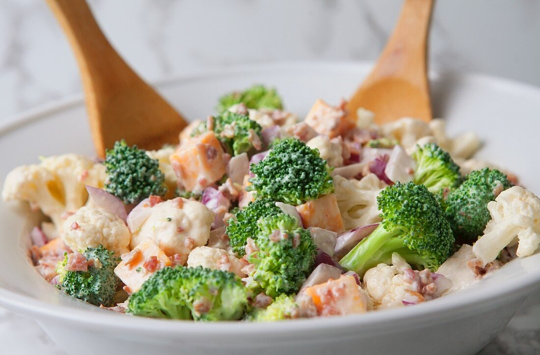 Salad with broccoli, cauliflower, bacon, cheese and a yogurt dressing